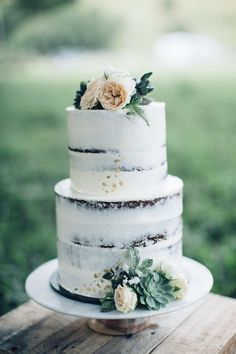 beautiful semi naked cake with succulents and peach colored flowers