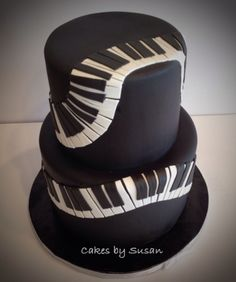 If your intimidated by having to create a complicated fondant music design, this cake is for you. If you notice, each key is separated and not perfect. This means you can roll out black and white fondant then just cut and place as you see fit on a fondant covered tiered cake or a well iced one. And voila! You have a piano key designed cake   via Cakes by Susan in Fort Collins, Colorado
