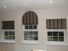 Roman Blinds and Stiff Pelmet to keep the shape of the arched window - Curtains and Blinds Shops Leeds