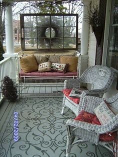 Porch wicker furniture with a vintage metal iron couch or is that a crib?  Old window frame for artwork.  Shabby and Cottage.