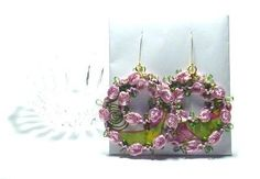 ModBlooms™                                     ModBlooms™ are mod hoops made with pretty quilting fabric with a mod theme. I made these with a flower embellishment that gives it an extra feminine flair. I used liquid stitch for a seamless finish. These hoops dangle by gold plated jump rings and hammered gold plated ear wires. They measure 3 1/2 inches from top of ear wire.  $33.00 Hammered Gold, Quilting Fabric, Embellishments, Dangles, Wire, Feminine, Quilts, Stitch, Christmas Ornaments