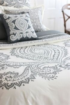 grey & white paisley. would love to see this up against a buttery yellow wall.