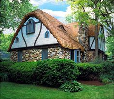 The thatch look can also be created using cedar shingles with a rolled eave.  The shingles are steamed to a curve shape to wrap around the eave overhangs.  The finished roof is in a wave pattern.  There are curved clay shingles that are available should a homeowner not want a cedar roof.  We have many plans with a rolled-eave roofline such as the Cozey-wold, Rose Cottage, Bunnbridge, and Pardiggle