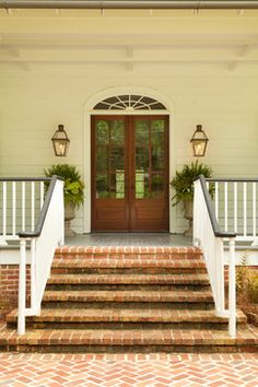 Raised Cottage - Zook Architects, LLC. Urns are beautiful & color of door.