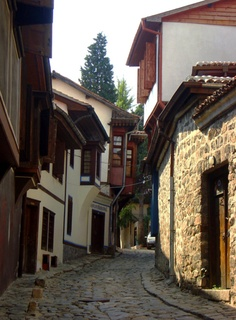"""Old Town, Plovdiv, Bulgaria. Plovdiv is the second-largest city in Bulgaria after the capital Sofia. Plovdiv is situated in south-central Bulgaria on the two banks of the Maritsa River. The city has historically developed on seven syenite hills, some of which are 820.21 ft high. Because of these hills, Plovdiv is often referred to in Bulgaria as """"The City of the Seven Hills."""""""