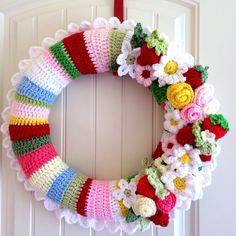 Custom wreath for Stacey. Strawberry Fields, 14 inch, white scallop trim in stripe colors pictured. Let me create a fully custom crocheted wreath exactly how you will love it.    How it works:    Pick your size. Pick your colors: even rows of stripes or varied pattern of stripes  Pick your trim: Option of a default scallop edging (or custom style edging) or NO edging  Pick your adornments: flowers, leaves, strawberries (or custom)  I will quote you a current turn time, create a custom…