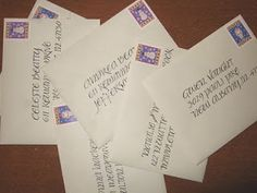 Envelopes hand lettered in pointed pen uncial calligraphy by Jan Hurst.