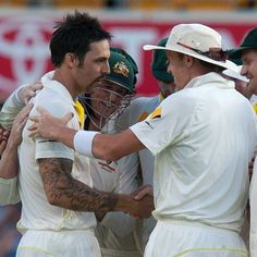 Johnson removes Anderson to win first Ashes Test | Australian bowler Mitchell Johnson is congratulated after he took the final wicket to win the first Ashes Test at the Gabba in Brisbane, November 24, 2013. AAP: Dave Hunt