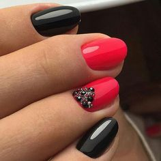 This classy mani uses black nail polish, a pop of color and embellishments