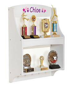 With five pegs for hanging ribbons and plenty of space for kids' hard-earned trophies on two shelves, this mountable trophy rack will commemorate their accomplishments in perfectly personalized style.Includes rack and wall-mounting hardware19'' W x 24'' H x 6'' DWoodSome assembly requiredRecommended for ages 3 years and upImported Wood Shelves, Floating Shelves, Shelving, Playroom Furniture, Kids Furniture, Trophy Shelf, Beyond The Rack, Table And Chair Sets, New Room