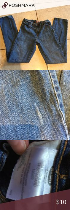 Old Navy - Boys blue jeans size 14. Old Navy boys blue jeans size 14. Slight fray on the front left leg (see close up pic) Great condition. Old Navy Bottoms Jeans