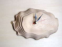...product...This clock is made of seven layers of precisely cut and engraved wood. The layers of wood resemble the growth rings of a tree. The clock will mount flat to the wall because the mechanism is fit inside the depth of the layers....finishing...The front side of the wood has been sanded. Battery (1x AA) not included....background...Growth rings, also referred to as tree rings or annual rings, can be seen in a horizontal cross section cut through the trunk of a ...