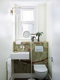 Looking for a way to add drama to a small bathroom? How about using some incredibly beautifu...