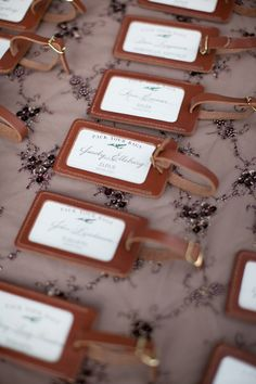 Travel inspired wedding on Style Me Pretty ~ Luggage tag favors doubles as escort cards. Photography by stephaniefay.com
