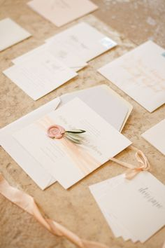 YONDER DESIGN | Victoria and Marco's Lake Como wedding is featured on Snippet & Ink. Blush silk ribbon, a custom wax seal, and live olive branches bring a sense of place to the Italian lakeside. Calligraphy by Della Torre Designs.