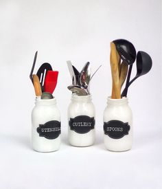 Painted Mason Jar Utensil Holders: Keep your kitchen utensiles with this DIY organization project.