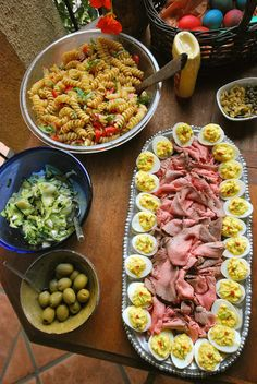 Easter spread with rare roast beef, deviled eggs, pasta salad, and zucchini salad.  WHAT THE HELL ARE THEY MAKING NOW? a kitchen adventure