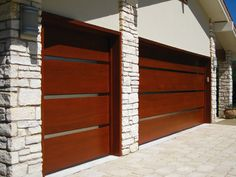 Modern Garage Doors Design | Contemporary Wood Garage Door with Stainless Steel Inlays installed at ...
