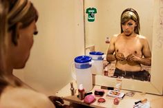 Malcolm Linton // Sex worker Oscar Villareal, 28, smokes crystal meth one evening in his room at a boardinghouse in downtown Tijuana. Crystal meth is a powerful aphrodisiac used by many of the city's sex workers. Oscar called himself Beto by day and would cruise a local park for clients as a gay man, but at night he became Alessandra, Alé for short, who worked the clubs and the streets of the red light district.