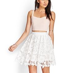 "New Crochet Lace Skirt This skirt features a floral crochet lace overlay and an invisible side zipper by forever21. Fully lined, 100% polyester, lightweight knit, 20"" full length. Color is true white. New with tag. Pair it with cami and a heeled sandals for a chic day look. Forever 21 Skirts"