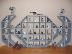 """Star Wars TIE Fighter Children's Wood Display Shelf """"Precision hand crafted wood display shelf with professional grey stone texture finish. Neutral color looks good with any home decor. Robust construction with continuous horizontal and vertical pieces. Kids will love stacking and displaying their Star Wars LEGO figures, LEGO designs and more! Can also be used for displaying rock collections, shells or favorite toys and keepsakes. Square compartments are each 3"""" wide x 3"""