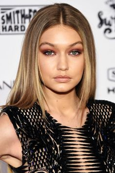 Gigi Hadid: Burgundy MonoAt an event last week celebrating the Sports Illustrated Swimsuit Issue release, Gigi Hadid sported rosy, almost burgundy lids alongside lips and cheeks in the same color family, only muted.