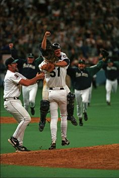 Dan Wilson jumps onto Randy Johnson in celebration of making it into the post season for the first time in 1995
