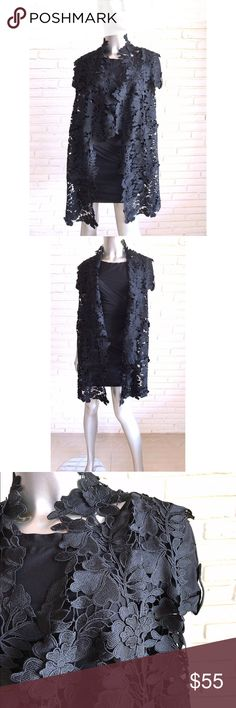 Elie Tahari Black Floral Lace Open Vest Jacket L Stunning Elie Tahari black open front vest in size L. Stunning heavy Floral design basically a form of lace. Meant to be worn open and loose fitting, hangs longer in the front and shorter in the back. Size large but will med and large due to its free shape. Gorgeous in person!!!!  34 inches long in back, 19 inches long in front, 24 inches arm pit to arm pit Elie Tahari Jackets & Coats Vests