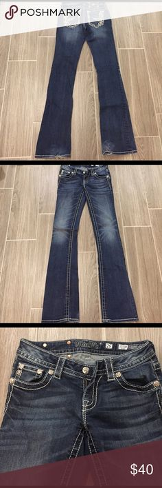 Bling Bootcut Jeans In excellent condition! Only worn a few times. SZ 25. Have some slight fraying at the bottom. Pictured in the 3rd image. No missing buttons or bling. Super comfortable jean! While these jeans are in great condition, they have been worn keep in mine when purchasing. All flaws pictured!  Bundled discounts. Ships same or next day. Offers welcome. No lowballs Miss Me Jeans Boot Cut