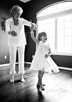 Little girl twirling and dancing with her Grandma.