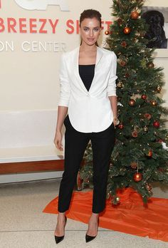 White blazer with black top and pants