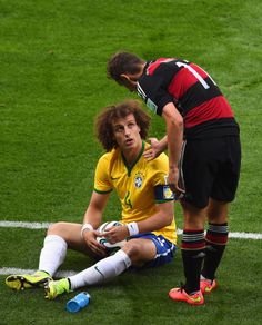 David Luiz of Brazil against Miroslav Klose of Germany in the 2014 World Cup