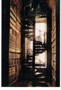 gorgeous space ... tall bookshelves and spiral stairs ... just needs a comfy place to sit and read
