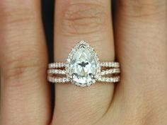 Rosados Box Tabitha Grande & Skinny Lima Rose Gold Pear FB Moissanite and Diamonds Halo Wedding Set $3,075 This engagement ring is designed for those who love simple with a slight twist. This gorgeous pear shaped forever brilliant moissanite is sure to grab some sophisticated attention! Simple and elegant, this ring will surely be timeless!! This band is 100% American made with non-conflict diamonds and recycled 14kt white gold.
