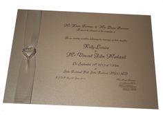 Cream and Ivory wedding invitation with silver diamante embellishment www.lilguy.co.uk