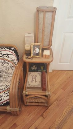 The divination storage table close up in the hallway/divination room. Where i store my different types of Tarot cards, Oracle cards, Rune stones and Ogham sticks all on the second tier (the key book is actually a box) and my Scrying Mirror and Crystal Ball in the basket on the bottom cubby/shelf, as well as the necessary tools & supplies needed to perform each form of divination, like candles, incense, oils, herbs, etc., etc. and so on and so forth.