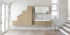 image salle de bain blanche au charme naturel aménagée avec des meubles en bois clair et décorée de brique blanche