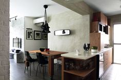 Real Good chairs, pendant light and mirror from Pomelo Home, and their dining table and stools from D'Bodhi. Black bowl and Cat sculpture from Lifestorey; containers from Molecule.