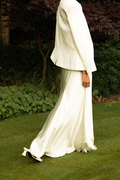 The ultimate simple wedding bias slip dress and chic jacket for the modern bride. A variation on our popular wide strap slip, this spaghetti strap version is cut lower on the decolletage and back for extra impact as you walk down the aisle. Made using our luxe ivory silk satin and fully lined with silk. Paired here with our tuxedo jacket for ultimate Bianca Jagger vibes. This is the cool, minimal wedding dress at its best. Perfect for city weddings, elopement weddings and relaxed weddings. Bridesmaid Skirts, Modest Wedding Dresses, Wedding Dress Styles, Minimal Wedding Dress, Winter Bridesmaids, Bridal Separates, Sophisticated Bride, Backless Wedding, Long Sleeve Wedding