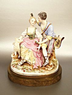 Meißen Shepherd and Shepherdess Porcelain Group Figurine  c. 19th century, Germany. Featuring young man and woman with flowers & sheep