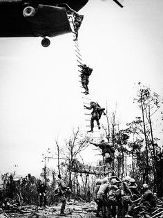 Helicopters, supposed to be able to land on a dime, found they couldn't touch down on narrow hilltops in the Central Vietnam coastlands, but that didn't stop them from delivering right on the money. Engineers blasted drop areas clear and the giant Chinook choppers dropped their soldiers of the 5th Battalion 7th Cavalry Regiment to participate in operation Thayer II some 15 miles southwest of Bong Son, which is some 300 miles northwest of Saigon. Feb. 1967. (AP Photo)