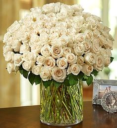 100 Premium White Roses in a Vase  by Houston Wedding Florist | Sicola's | #wedding #flowers