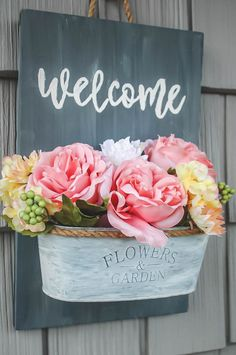 Personalize your front door decor with this easy welcome sign you can make on a budget. This Farmhouse sign will add a lot of curb appeal to your front door. Dollar Tree Flowers, Dollar Tree Crafts, Diy Concrete Planters, Metal Planters, Welcome Signs Front Door, Front Door Decor, Diy Hydro Dipping, Welcome Flowers, Diy Candles Scented