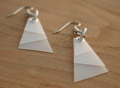Recycled Milk jug earrings... Fabulous!  Color, paint, use cloth to cover, endless possibilities