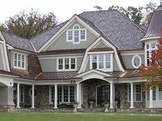 rock, gables, white trim, copper roofs