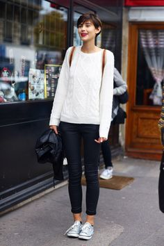 White cable knit sweater.  Cable knit: Cable knitting is a style of knitting in which the order of stitches is permuted.  Sweater: A knitted garment typically with long sleeves, worn over the upper body.  Crystal Wu, FMM1B2