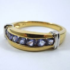 7 Round Cut Tanzanite Ring. Set in 14K White and Yellow Gold. - $375