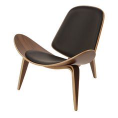 The Carl Hansen Shell Chair has such a dominant presence that it wasn't a popular furniture piece when Hans J. Wegner designed it in 1963. Some critics loved it, but it was the general publics reluctance to accepr the chair's bold and different design and was only produced in limited quantities.