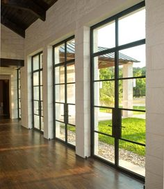 Black wrought iron and crisp lines make these oversized doors a highlight in this lake house | Durango Doors