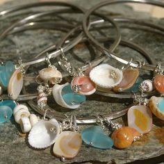Sea Shell Bangle Mother of Pearl  Bridesmaid by HaoleGirlHaiku Just gave me an idea on what to do with my seashells.